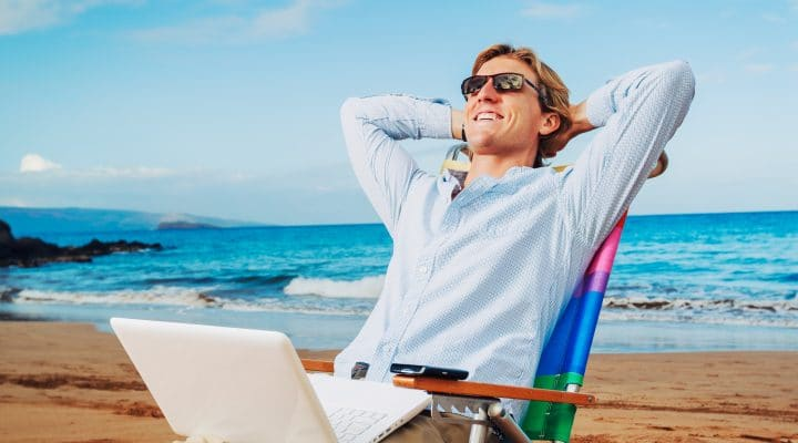 Young Business Man Relaxing on Tropical Beach